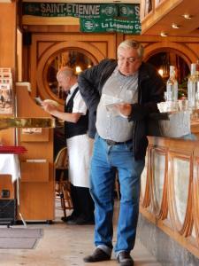 Man Reading at Bar